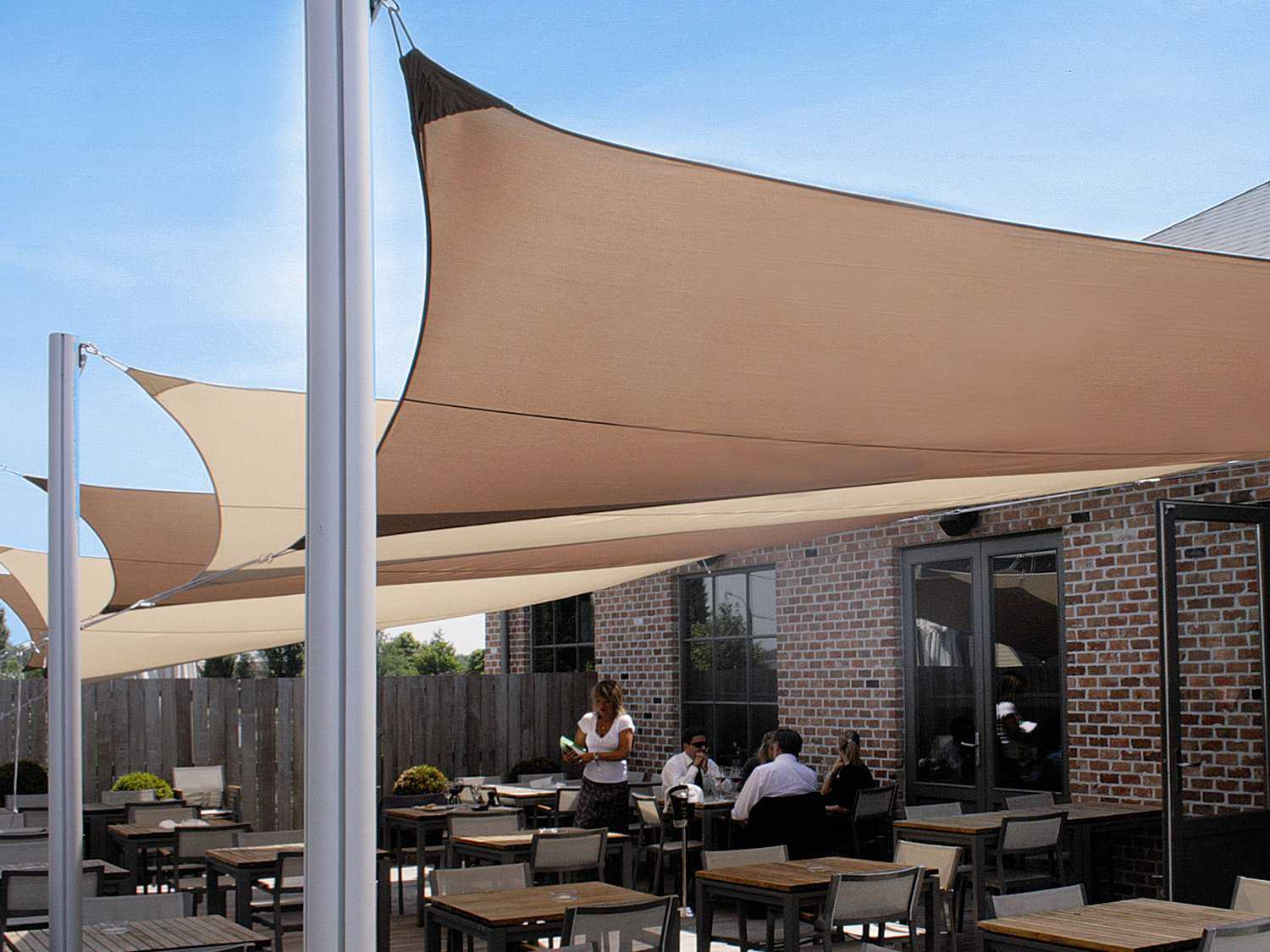 Sail awnings for patio - 13 Cool Shade Sails For Your Backyard Canopykingpin Com
