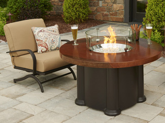 A fire pit table instantly transforms your backyard into a cozy campfire. Learn more about fire pit table styles, materials, types of fuels, sizes, and care.