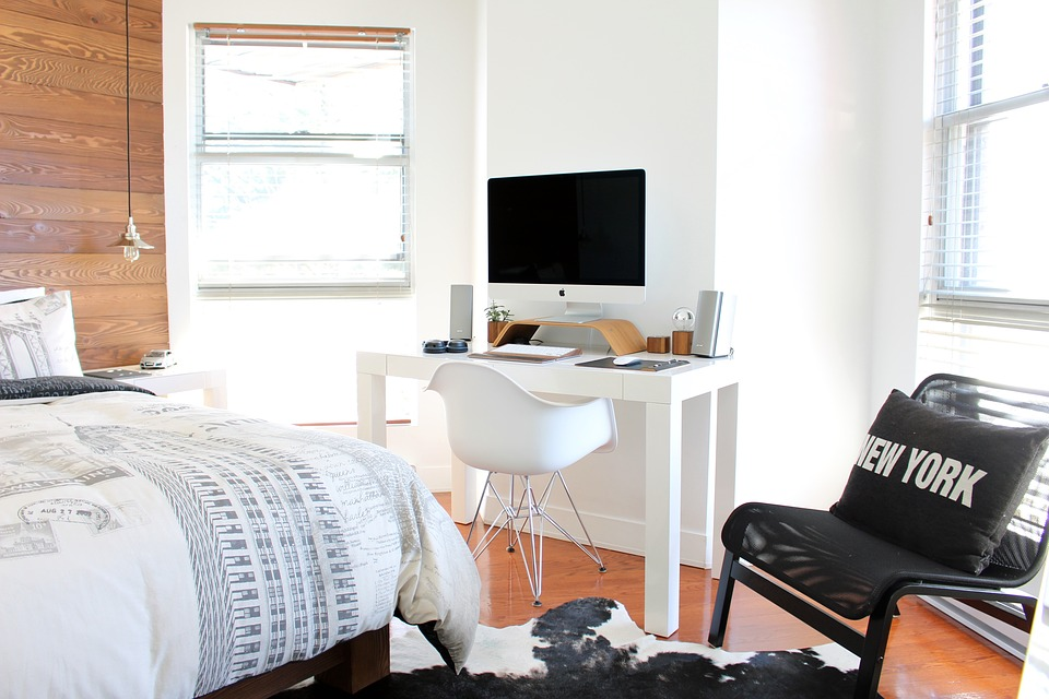 Comfortable bedroom with small working space