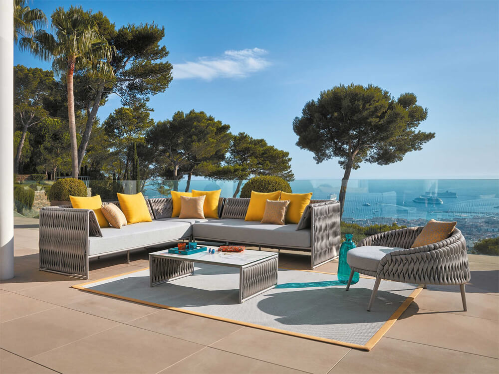 Telescope outdoor furniture is arranged around a pool
