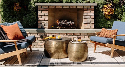 Getting your indoor space ready for fall means breaking out the candles and blankets. Treat your outdoor space to the same treatment.