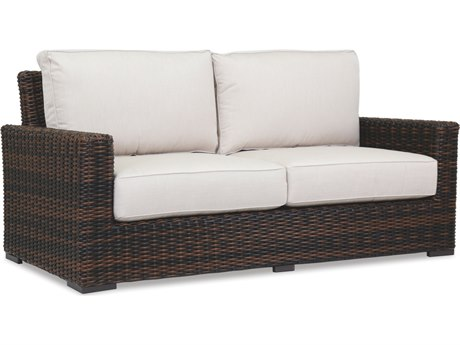 Sunset West Quick Ship Montecito Wicker Loveseat in Canvas Flax with Self Welt