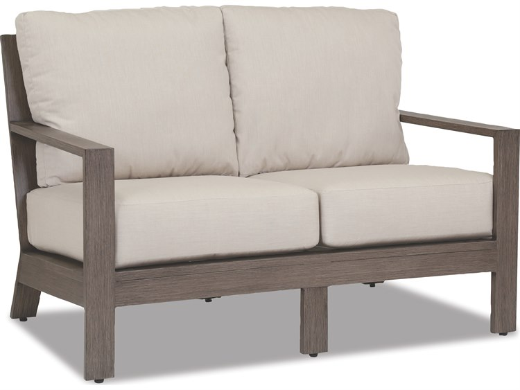 Sunset West Quick Ship Laguna Aluminum Loveseat in Canvas Flax with self welt PatioLiving