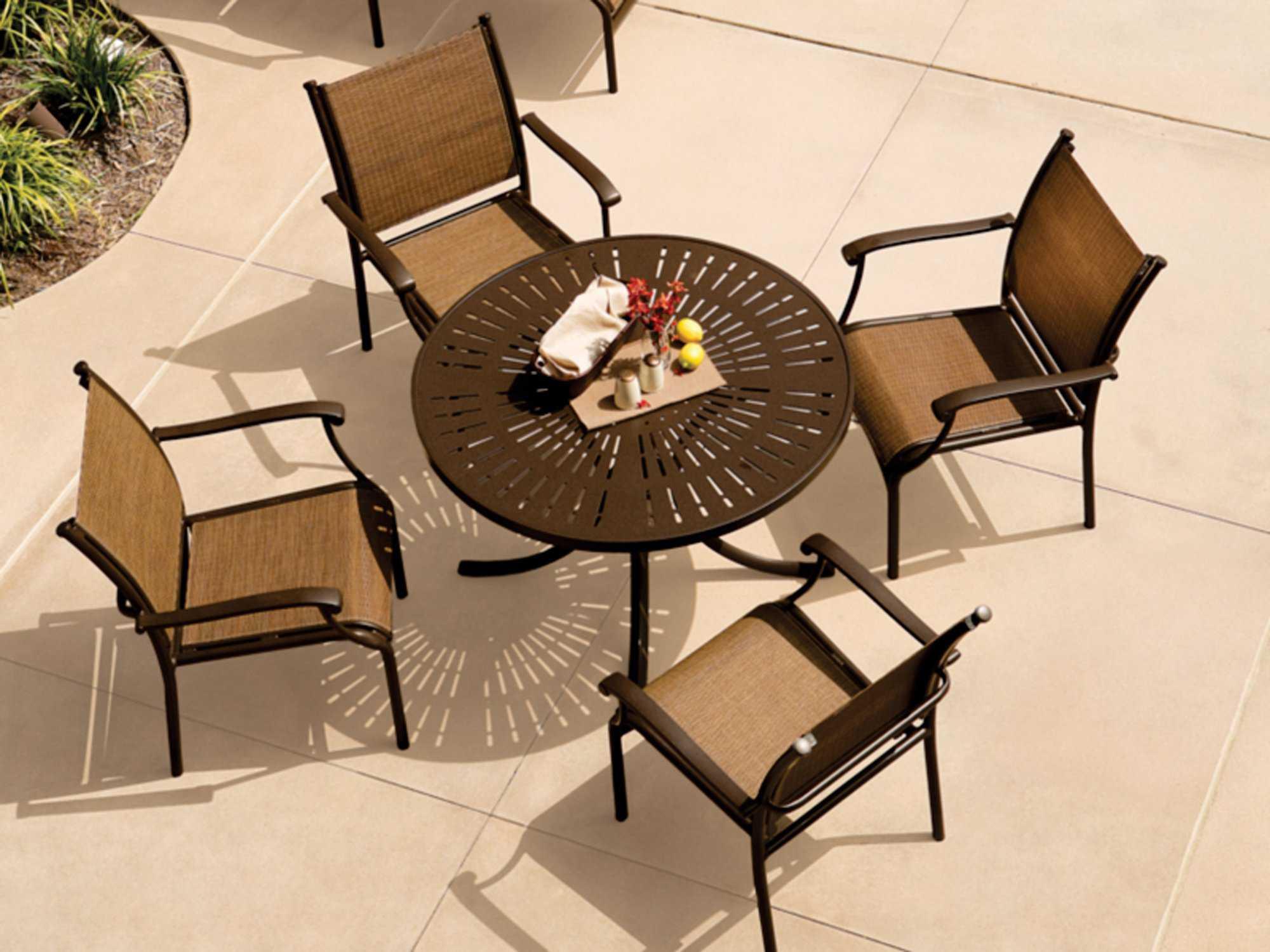 Tropitone la stratta aluminum 42 round dining table with - Aluminium picnic table with umbrella ...