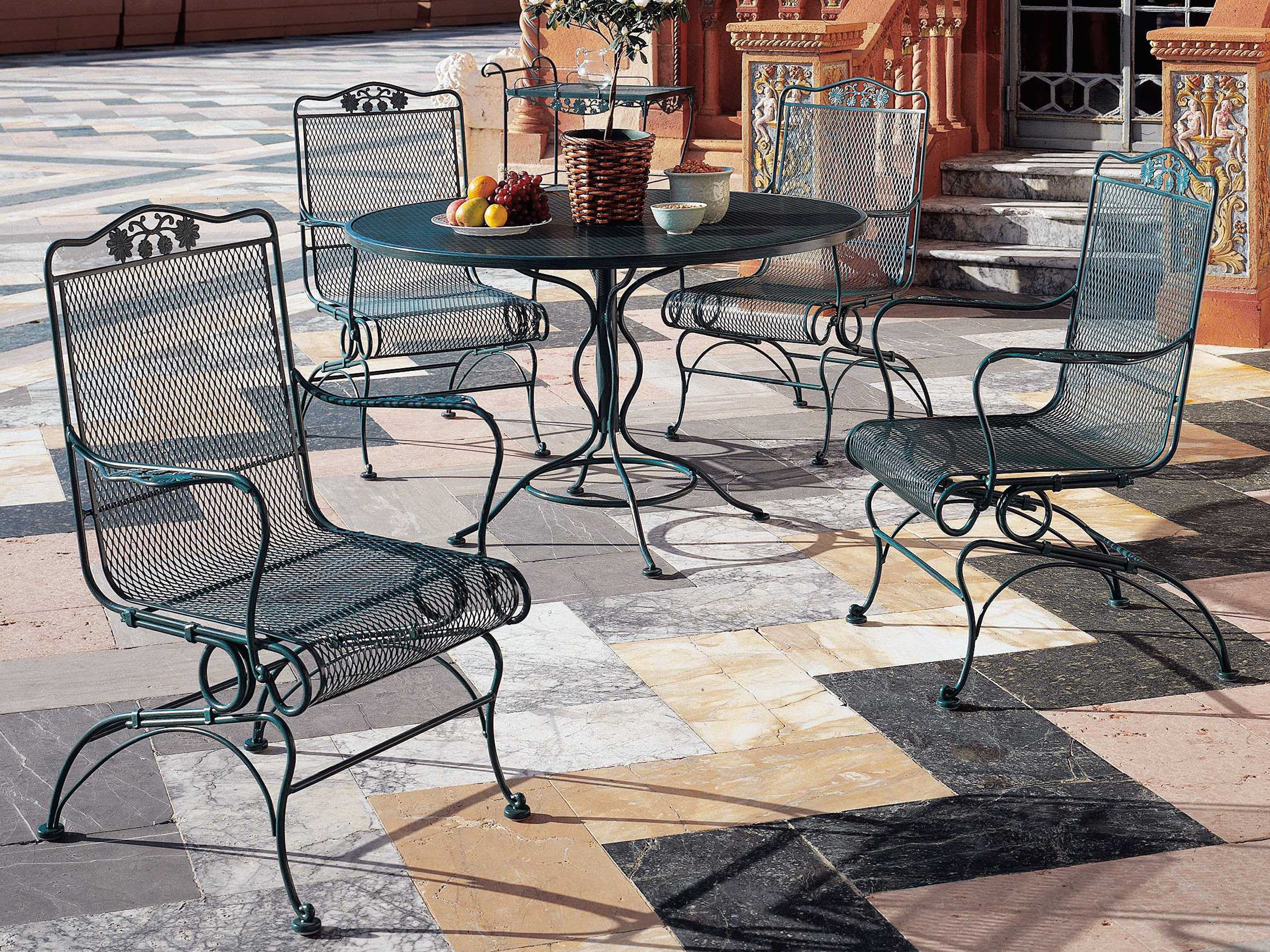 5583e64272a5 ... Woodard Mesh Wrought Iron 48 Round Curved Legs Table with Umbrella Hole  190137 ...