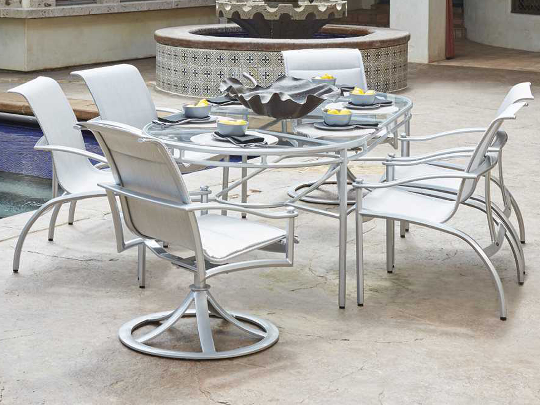 Woodard nob hill padded sling aluminum dining arm chair for Woodard patio furniture