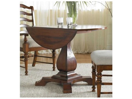 Luxe Designs Distressed Antique Cherry 44'' Wide Round Drop Leaf Pedestal Dining Table LXD4677521582